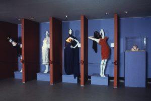 Four mannequins dressed in contemporary feminine garments