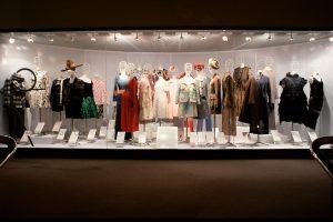 Display cabinet of mannequins dressed in feminine garments