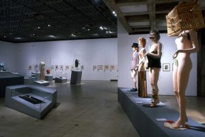 Exhibition display of mannequins and prints