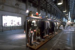 Exhibition display of a row of uniforms and masculine garments