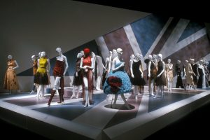 Exhibition display of feminine garments with a Union Jack flag as background