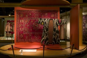 Asian style garment displayed in front of carpet