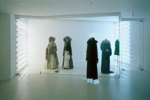 Exhibition display of five mannequins in feminine dress