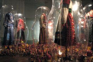 Exhibition display of dressed mannequins in transparent cases