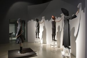 Exhibition display of four dressed mannequins