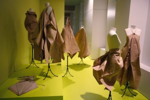 Exhibition display of mannequins dressed in paper