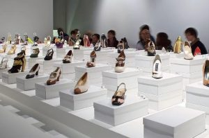 Exhibition display of shoes on boxes