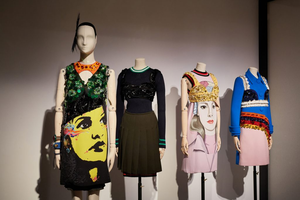 A row of four mannequins dressed in contemporary feminine skirts, tops and dresses