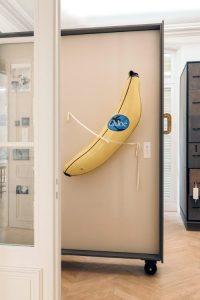 Inflatable banana branded with Chloe logo mounted on wall