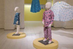 Exhibition display of dressed children's mannequins