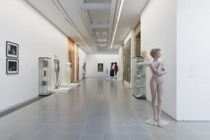 Exhibition display of corridor and unclothed mannequins