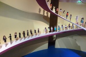 Exhibition display of dolls on curved runway