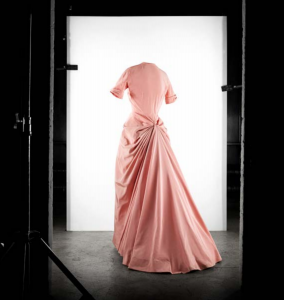 Exhibition display of dressed mannequin in pink dress