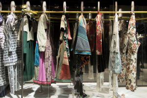 Exhibition display of clothes hanging on a rail
