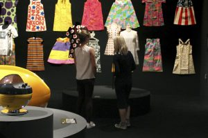 Exhibition display of dresses mounted on wall