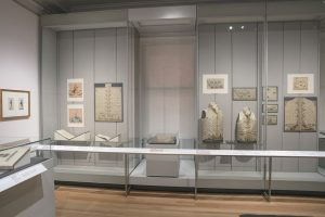 Exhibition display of waistcoats in glass cases