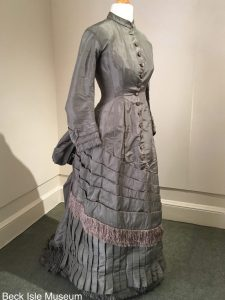 Exhibition display of dressed mannequin in Victorian dress