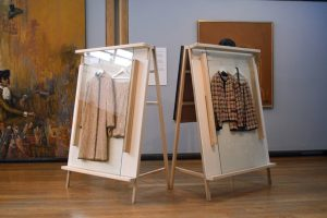 Exhibition display of garments in A frames