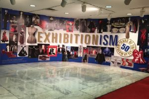 Exhibition title banner and imagery on display