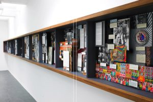 Exhibition display of ephemera in wall mounted case