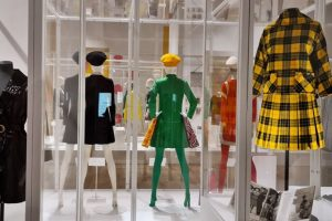 Rear view of exhibition display of dressed mannequins