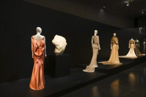 Exhibition display of dressed mannequins rear view
