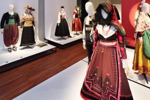Exhibition display of dressed mannequins in traditional clothing