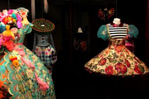 Exhibition display of dressed mannequins in floral tutu style dresses