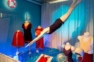 Exhibition display of dressed mannequins in swim wear