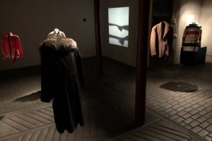 Exhibition display of suspended garments