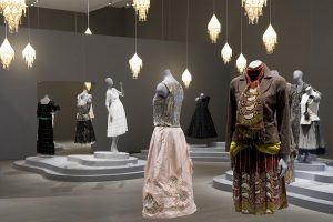 Exhibition display of dressed mannequins with lighting
