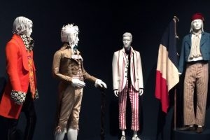 Exhibition display of dressed mannequins in menswear