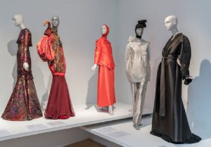 Exhibition display of dressed mannequins on plinths