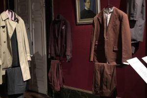 Exhibition display of hanging menswear suits