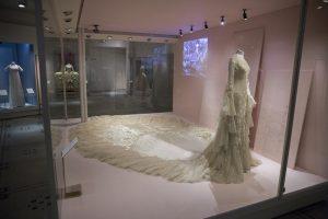 Exhibition display of dressed mannequin in wedding attire