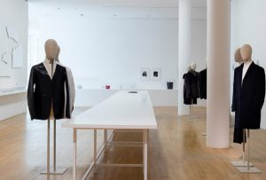 Exhibition display of dressed mannequins and trestle table
