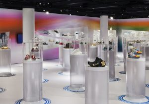 Exhibition display with shoes on round plinths