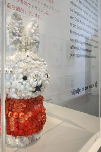Exhibition display of toy covered in buttons