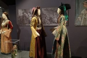 Exhibition display of dressed mannequins and images