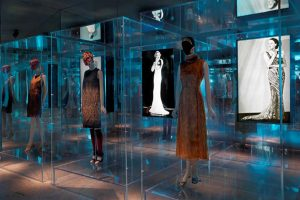 Exhibition display of dressed mannequins and imagery