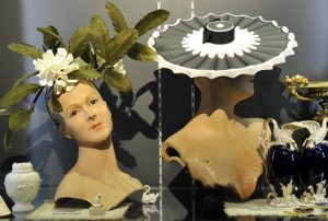 Exhibition display of mannequins with headpieces