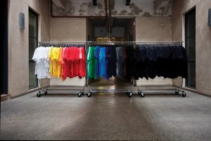 Exhibition display of t-shirts hanging on a rail