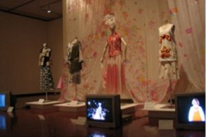 Exhibition display of dressed mannequins and films