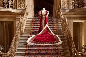 Exhibition display of dressed mannequin on stairs