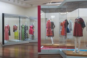 Exhibition display of dress in glass vitrines
