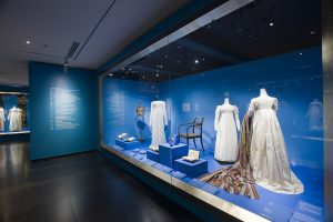 Exhibition display of dress within built in glass vitrine
