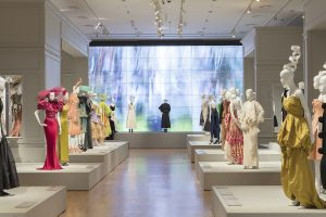 Room view of exhibition display of dress on open display plinths