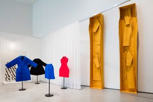 Exhibition display of dressed mannequins and artworks