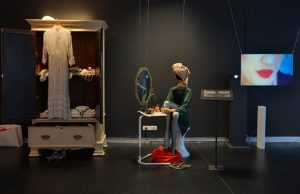 Exhibition display of dressed mannequin and image