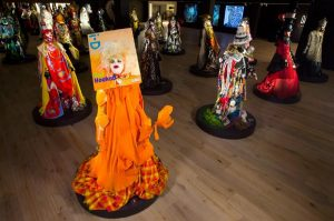 Exhibition display of mannequins dressed in brightly coloured garments